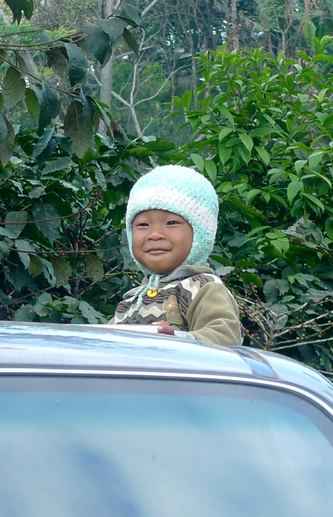 What a lovely child! He is smiling to us….